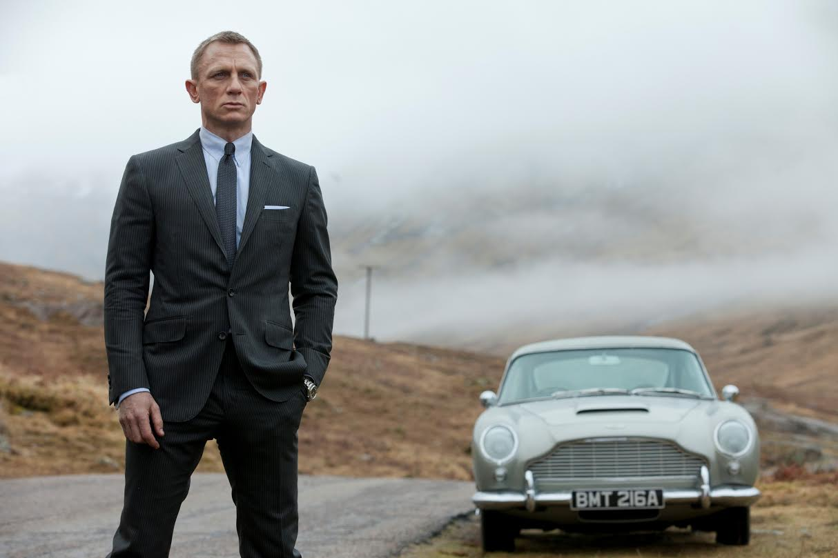 Bond (Daniel Craig) takes in the view of the countryside that he grew up in, the Scottish highlands